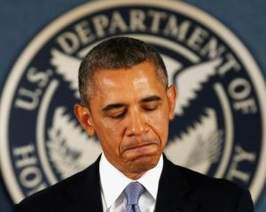 US President Barack Obama speaks about the government shutdown during a visit to the Federal...