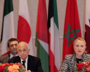 US Secretary of State Hillary Clinton speaks during the Friends of Syrian People Ministerial as...