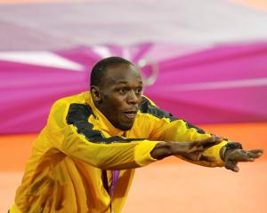 Usain Bolt celebrates after receiving his gold medal for the men's 4x100m relay. REUTERS/Gary...