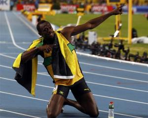 Usain Bolt of Jamaica celebrates winning the men's 200 metres final. REUTERS/Michael Dalder