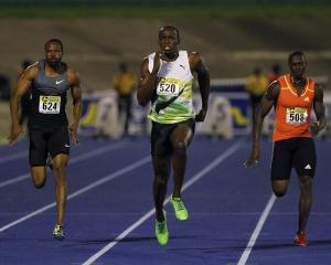 Usain Bolt of Jamaica sprints to win the men's 100 metres event at the Jamaica International...