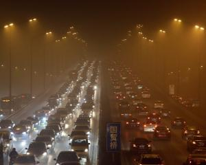 Vehicles are driven on the Third Ring Road in Beijing yesterday. REUTERS/Jason Lee