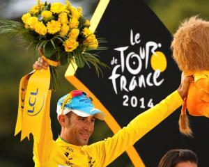 Vincenzo Nibali celebrates his overall victory on the podium after the 137.5 km final stage of...