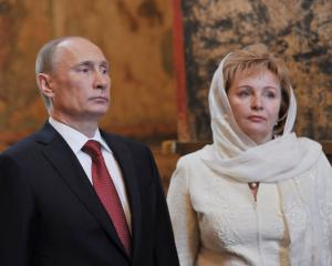 Vladimir Putin and his wife, Lyudmila, attend a service to mark the start of his term as Russia's...