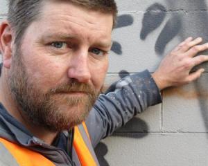 Volunteer Darryl Angus removes graffiti for the Dunedin City Council. Photo by Jonathan Chilton...