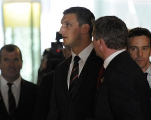 Wales captain Sam Warburton, centre, prepares to face a red card hearing in Auckland after being...