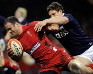 Wales' Jamie Roberts (L) on his way to the tryline against Scotland. REUTERS/Rebecca Naden