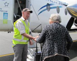 Wanaka Airport manager Ralph Fagan lends former Wanaka Community Board chairwoman Ngaire...