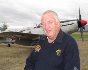Warbirds Over Wanaka International Airshow volunteer Bill Gordon, of Omarama, with his favourite...