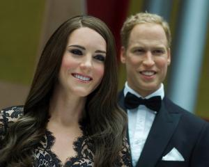 Wax figures of Kate Middleton, Duchess of Cambridge, and Prince William are displayed during a...