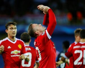Wayne Rooney celebrates after scoring his first goal. Photo Reuters