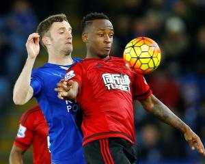 West Brom's Saido Berahino (R) in action with Leicester City's Andy King. Photo: Reuters