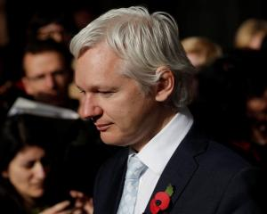 WikiLeaks founder Julian Assange leaves the High Court in central London after the court ruled he...