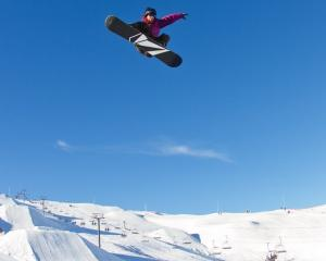 Will Jackways, of Wanaka, takes off on his way to winning the Electric Hip snowboarding big air ...
