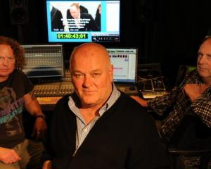 Working on the 100th episode of I Survived for A&E TV are (from left) NHNZ editor Mark Orton,...