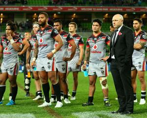A dejected Andrew McFadden with his team after the match. Photo Getty