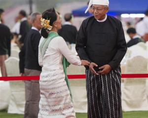 Burma's new President Htin Kyaw welcomes National League for Democracy party leader Aung San Suu...