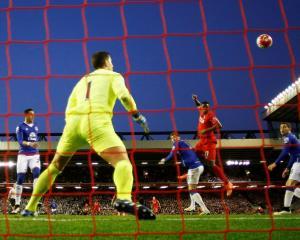 Divock Origi scores the first goal for Liverpool. Photo: Reuters