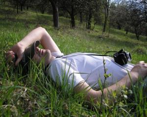 Man-relaxing-in-the-grass_8954-480x359_4811108310.jpg