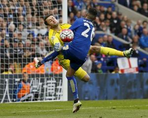 Swansea keeper Lukasz Fabianski saves an effort from Leicester City's Riyad Mahrez. Photo Reuters