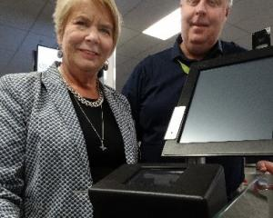 Customs Minister Nicky Wagner and Queenstown Airport operations general manager Mike Clay try out...