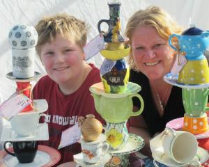 Debbie Beatson, of Wingatui, and her son Daniel (10) display their colourful garden totems at the...