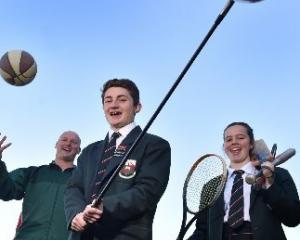 Head of sport Jeremy Scott and year 13 pupils Jesse Irvine (left) and Jess Chisholm (both 17)...