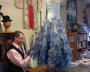 New Zealand Ballet Costumier James Kelly works on Glinda the Good Witch's costume complete with...