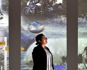 Otago Museum planetarium producer Oana Jones visits the museum's  Beautiful Science Gallery,...