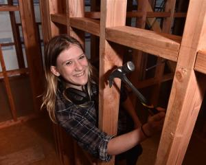 Otago Polytechnic level 4 certificate in carpentry student Megan Roberts works on her class house...