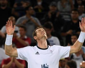 Andy Murray celebrates his victory over Juan Martin Del Potro. Photo Reuters