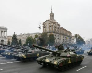 Ukrainian T-64 tanks drive during Ukraine's Independence Day military parade in central Kiev on...