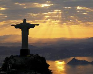 Christ The Redeemer is seen at  sunrise in Rio de Janeiro  this week.  Photo by Reuters.