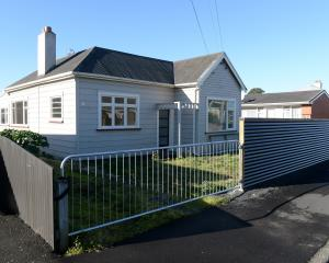 The uninhabitable home at 38 Richmond St, Forbury, which the owner plans to demolish and replace...