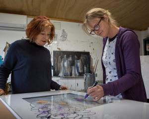 Hullabaloo member Gail de Jong (left) watches past member Odelle Morshuis prepare work for the...