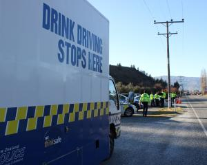 Police finish a morning checkpoint operation at the Cromwell entrance to the Kawarau Gorge. Photo...