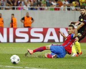 Sergio Aguero scores for Manchester City. Photo: Reuters
