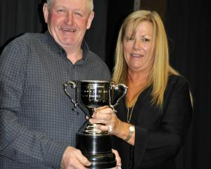 Titan Banner's trainer Graeme Anderson and Dunedin Casino general manager Karen Williams with the...