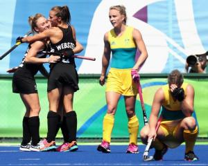 Australia players are devastated after losing their Olympic quarterfinal to New Zealand. Photo:...