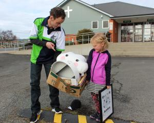James Winter and daughter Janae (7) collect some of the donated items to take to their new home...