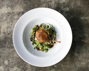 Confit duck with kohlrabi, capers and watercress.