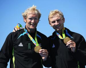 Kiwi pair Eric Murray (L) and Hamish Bond after winning their second consecutive Olympic gold...