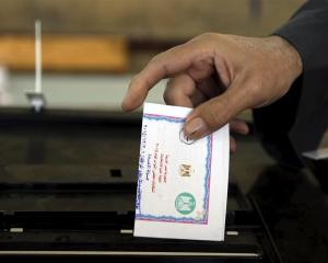Casting a vote in Egypt's elections last year. Photo by Reuters.