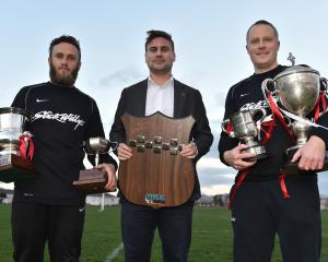 Caversham captains Rhys Henderson (left) and Mike Smith (right) and player-coach Tim Horner with...