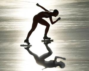 China's Shi Xiaoxuan skates in the women's 1500m speed skating event at the first winter Youth...