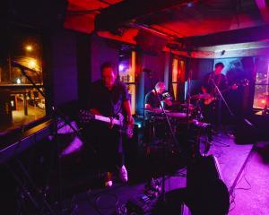 Shayne P Carter (left),  drummer Gary Sullivan and bassist James Duncan light up a full house ...