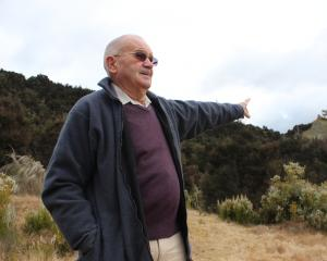 Tuapeka Lawrence Community Company chairman Peter Cummings points out the proposed location of a...