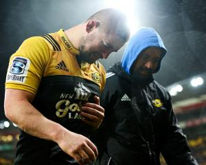 Dane Coles leaves the field after breaking his ribs last weekend. Photo: Getty Images