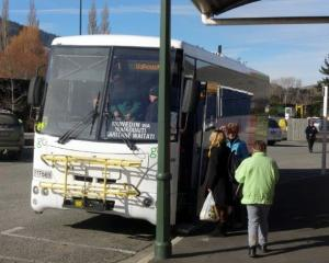 Passengers board a bus in Bond St yesterday. Buses are still calling at the old stop. Photo by...