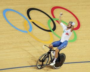 Elia Viviani celebrates after winning the omnium. Photo: Reuters